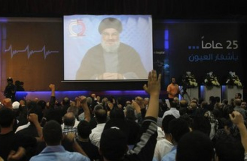 nasrallah speech on tv 370 (photo credit: REUTERS)