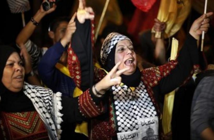 palestinians celebrate prisoner release 370 (photo credit: REUTERS)