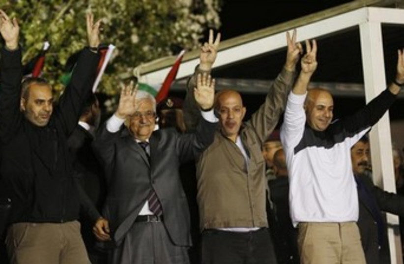 PA President Mahmoud Abbas with released terrorist prisoners in Ramallah (photo credit: REUTERS/Ammar Awad)