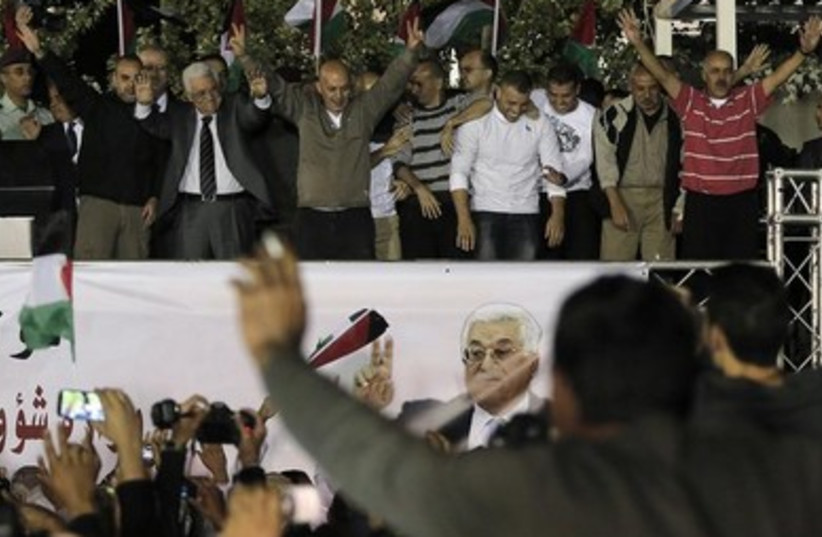 Abbas with released prisoners in Ramallah 390 (photo credit: REUTERS/Ammar Awad )
