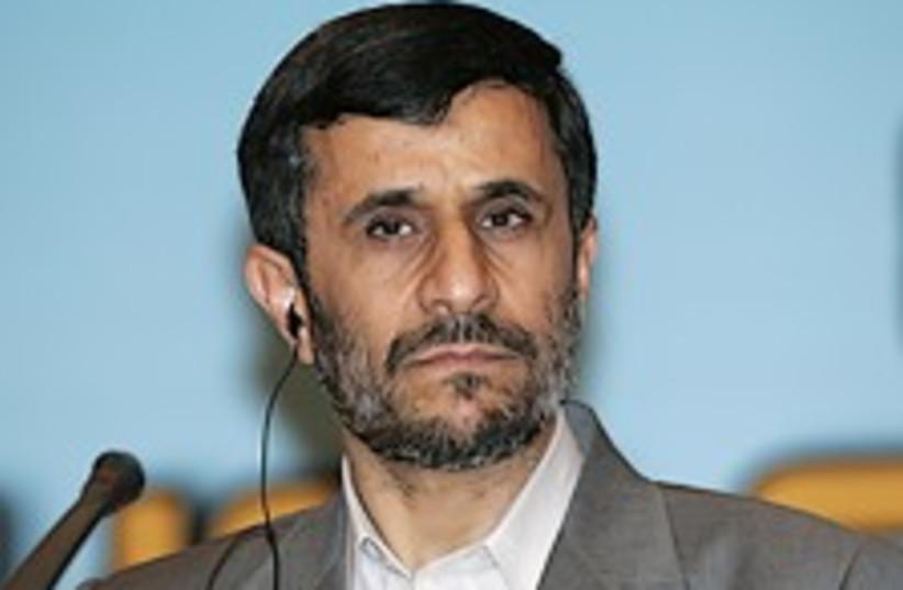 ahmadinejad listens 224. (photo credit: AP)