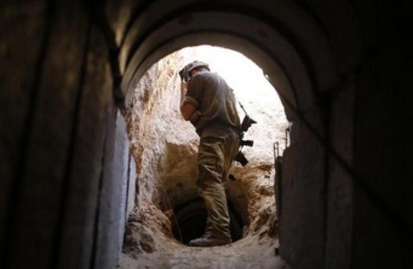 IDF soldier at Gaza tunnel 370 (photo credit: REUTERS/Amir Cohen)