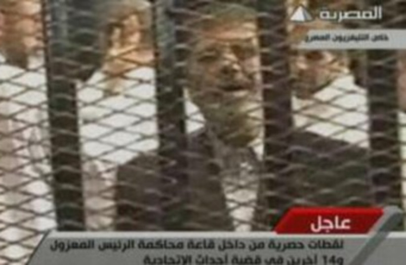 Morsi in first trial appearance 370 (photo credit: Screenshot)