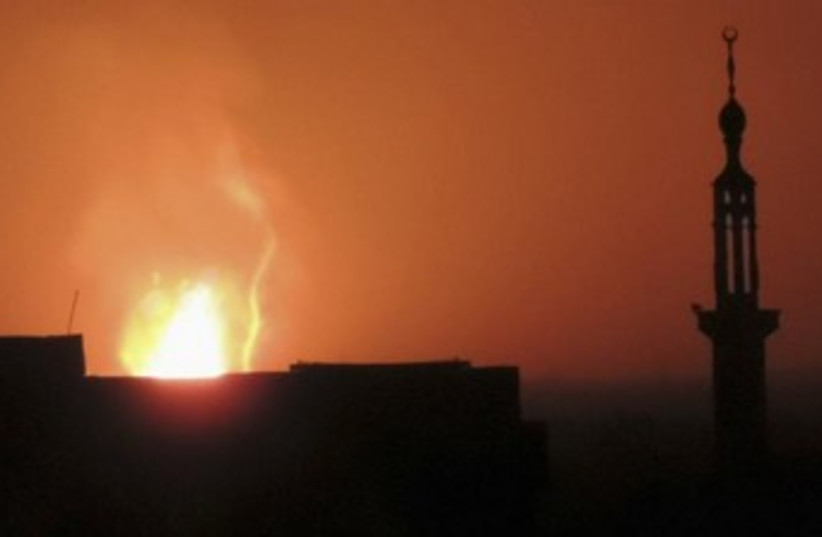 Fire seen rising above Damascus 370 (photo credit: REUTERS)
