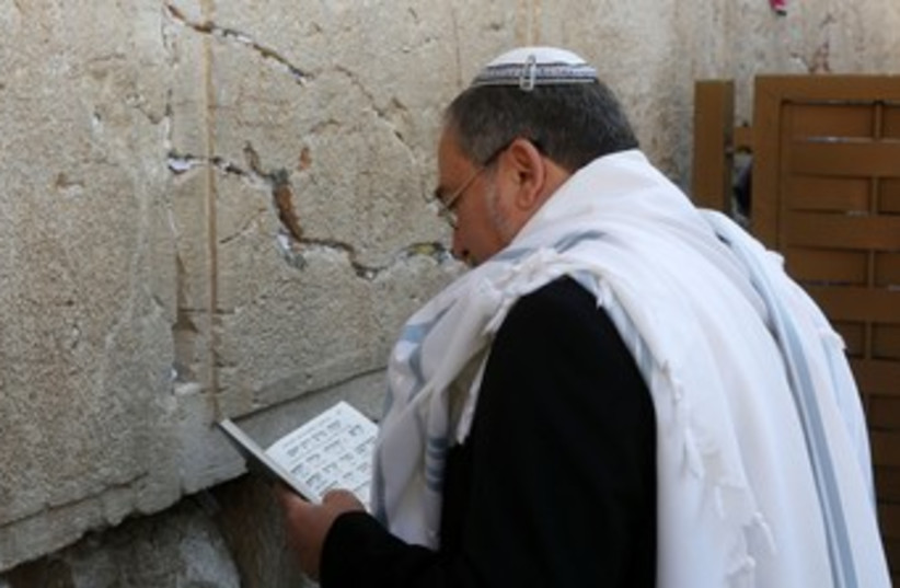 Liberman prays at Western Wall 370 (photo credit: Marc Israel Sellem/The Jerusalem Post)