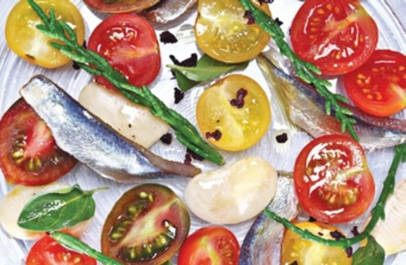 Fresh anchovies and cherry tomatoes (photo credit: Dan Peretz)