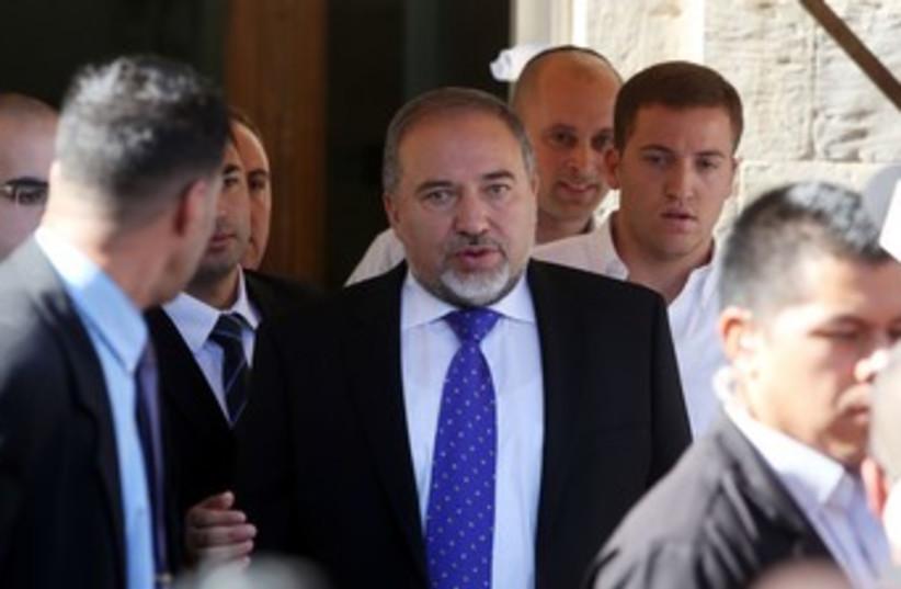 Liberman leaving court 370 (photo credit: Marc Israel Sellem/The Jerusalem Post)