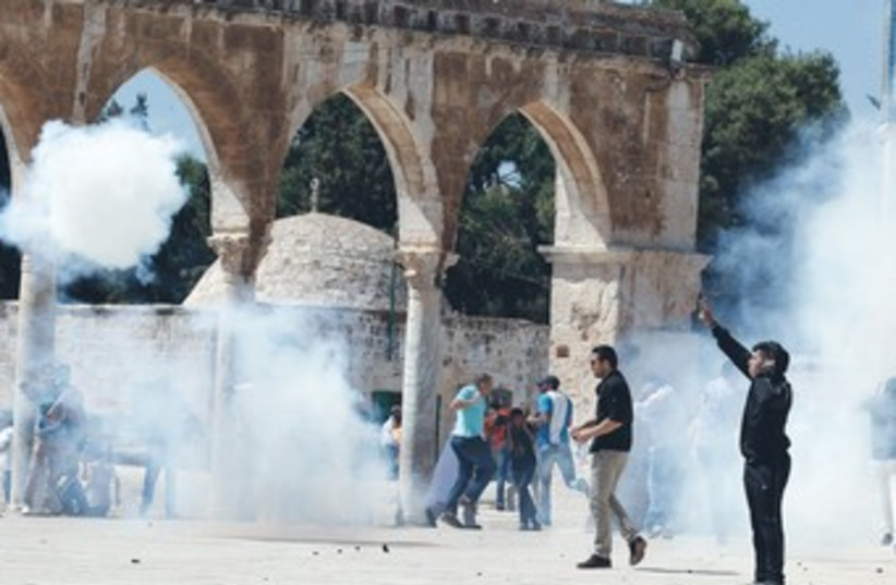 Palestinian protesters on Temple Mount 370 (photo credit: Ammar Awad/Reuters)