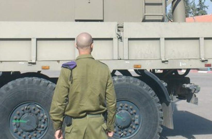idf guy with truck 370 (photo credit: yaakov lappin)