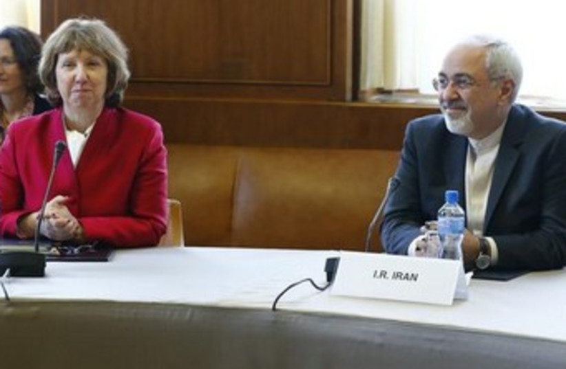 Catherine Ashton and Mohammad Zarif at nuclear talks 370 (photo credit: REUTERS/Denis Balibouse)