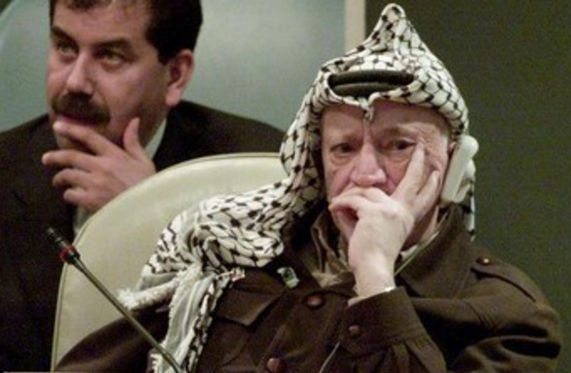 Yasser Arafat looking unhappy 370 (photo credit: REUTERS/Mike Segar)