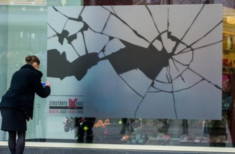 Kristallnacht stickers in Germany 370 (photo credit: REUTERS)