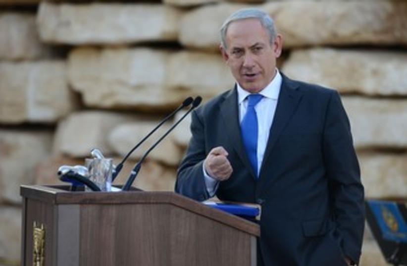 Netanyahu making fist looking at camera 370 (photo credit: Koby Gidon/GPO)