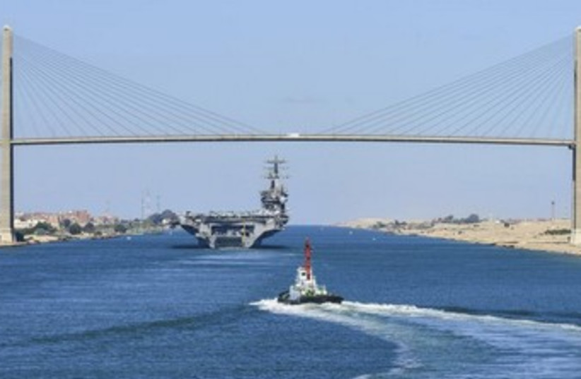 A US aircraft carrier in transit on the Suez Canal 370 (photo credit: REUTERS/US Navy/Mass Communication Specialist 3rd )