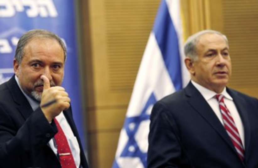 Liberman at Likud Beytenu faction meeting 370 (photo credit: REUTERS)