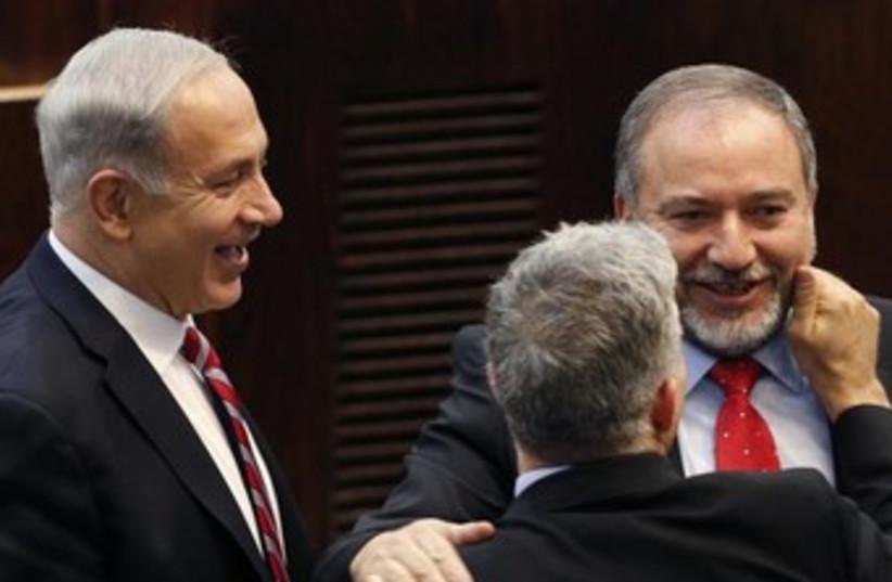 FM Liberman, PM Netanyahu, and Finance Min. Lapid 370 150 (photo credit: REUTERS)