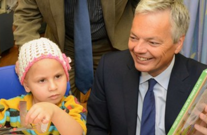 Belgium's foreign minister Didier Reynders with patient 370 (photo credit: Courtesy, Hadassah)