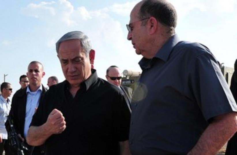 Netanyahu and Yaalon talking 370 (photo credit: Courtesy Defense Ministry)