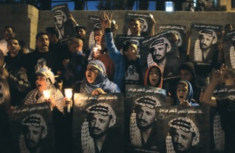 Palestinians hold Arafat rally 370 (photo credit: Ammar Awad/Reuters)