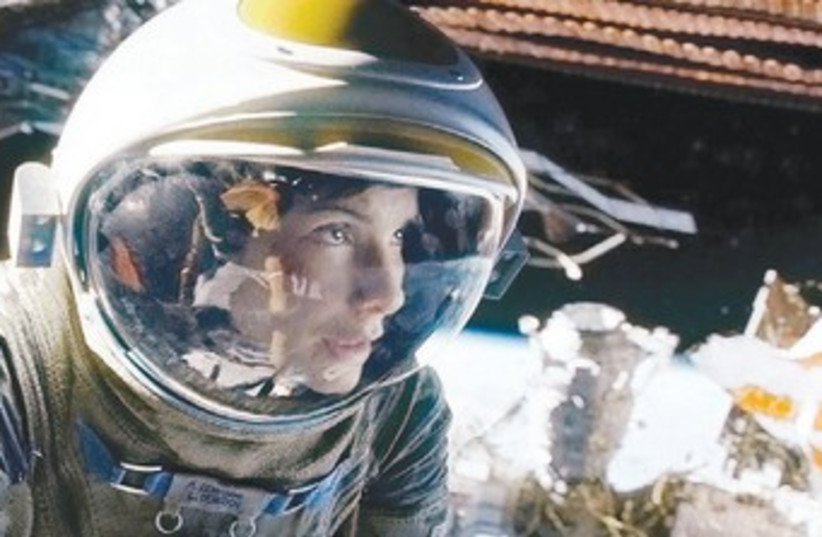 Gravity, starring Sandra Bullock and George Clooney (photo credit: Courtesy)