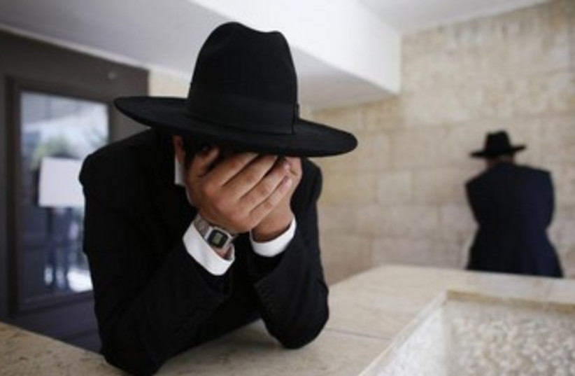 Ultra-orthodox man crying 370 (photo credit: REUTERS/Ronen Zvulun)