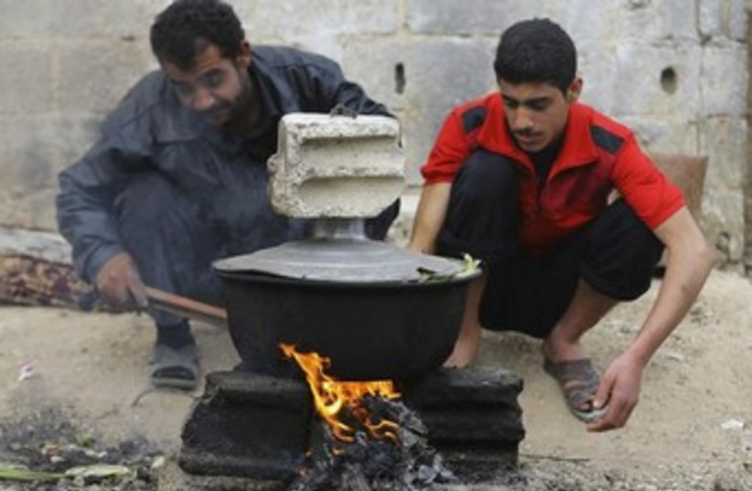 Syrians cope with gas shortage in Damascus 370 (photo credit: REUTERS)