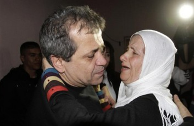Moayyad Hajji hugs his sister after his release from prison  (photo credit: REUTERS)