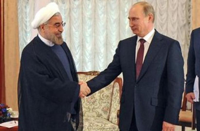 Russian Pres. Putin and Iranian Pres. Rouhani 370  (photo credit: REUTERS)