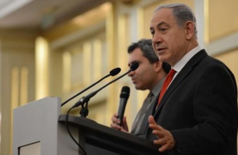 Netanyahu in Russia speaking 370 (photo credit: Koby Gideon/GPO)