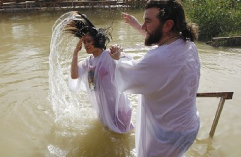 baptism ceremony Jordan river 370 (photo credit: Reuters)