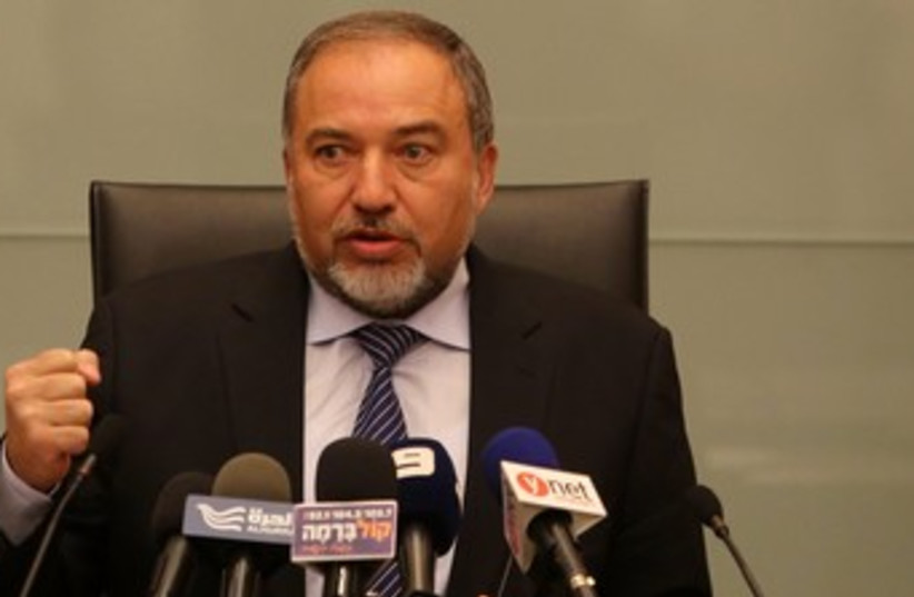 Liberman raising fist 370 (photo credit: Marc Israel Sellem/The Jerusalem Post)