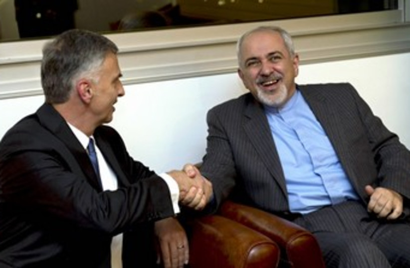 Iranian FM Zarif with Swiss FM in Geneva 370 (photo credit: REUTERS)