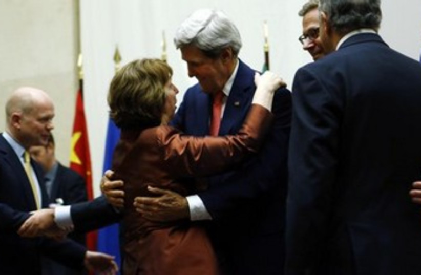 US Sec. of State Kerry hugs EU foreign policy chief Ashton37 (photo credit: Reuters)