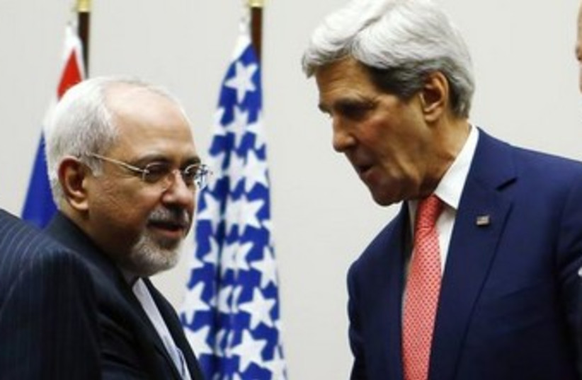 Kerry and Zarif shake hands in Geneva 370 (photo credit: REUTERS/Denis Balibouse)