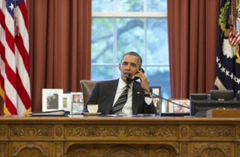 Obama in Oval Office on the phone 370 (photo credit: REUTERS/Pete Souza/The White House/Handout via Reu)