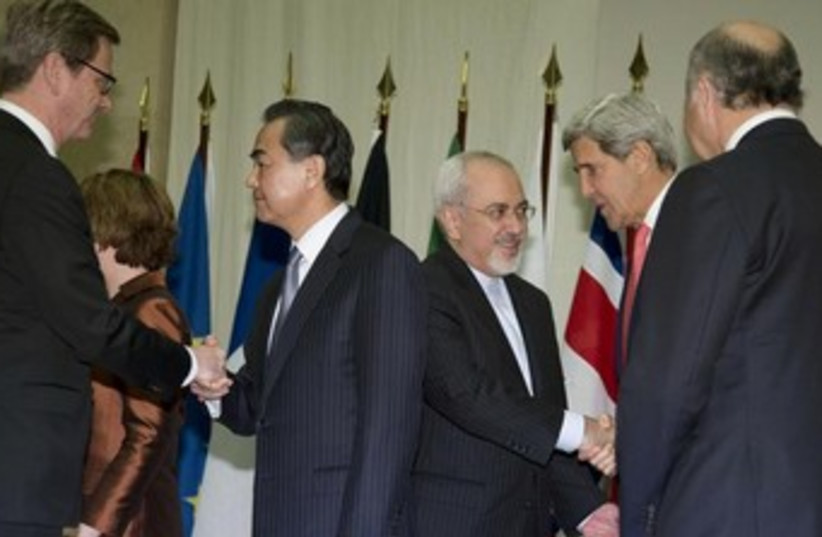 Zarif and Kerry at Iran nuclear talks in Geneva 370 (photo credit: REUTERS/Carolyn Kaster/Pool)