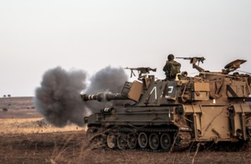An IDF artillery vehicle on the Golan Heights 370 (photo credit: IDF Spokesperson Unit)