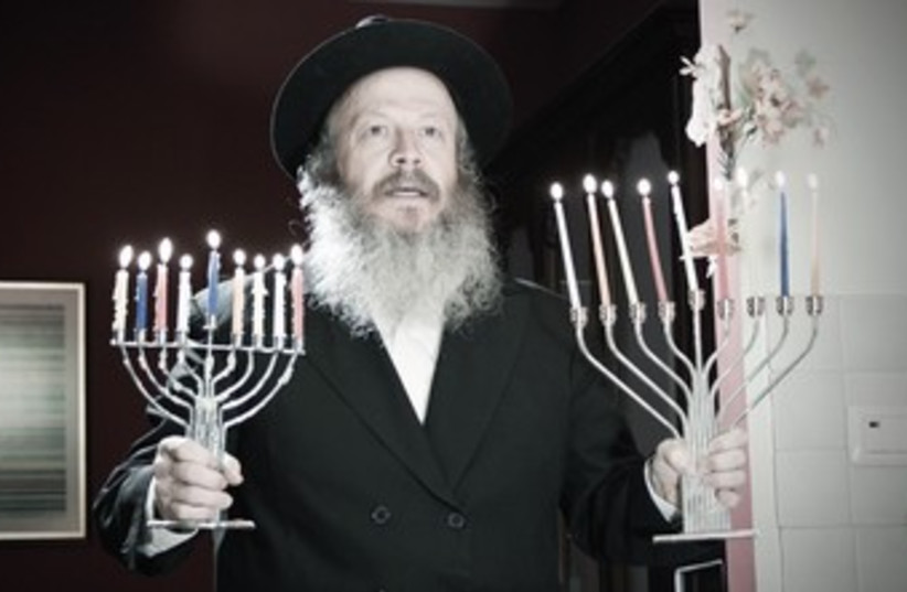 Hassid with menorah 370 (photo credit: Courtesy)
