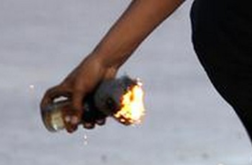 molotov in hand 370 (photo credit: REUTERS)
