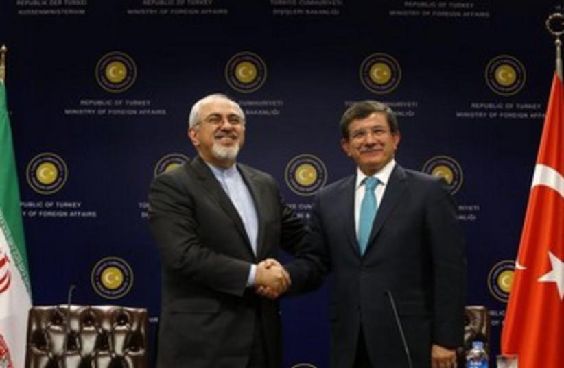 Iran FM Zarif and Turkish FM Davutoglu 370 (photo credit: REUTERS/Umit Bektas )