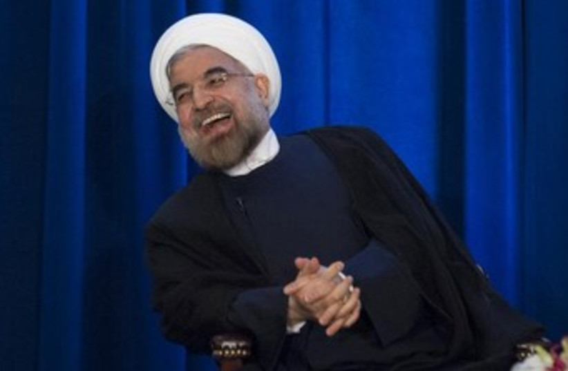 Rouhani laughing 370 (photo credit: REUTERS/Keith Bedford )