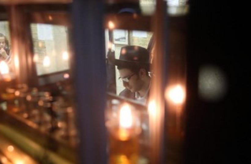First night of Hannuka in Jerusalem (photo credit: Marc Israel Sellem/The Jerusalem Post)