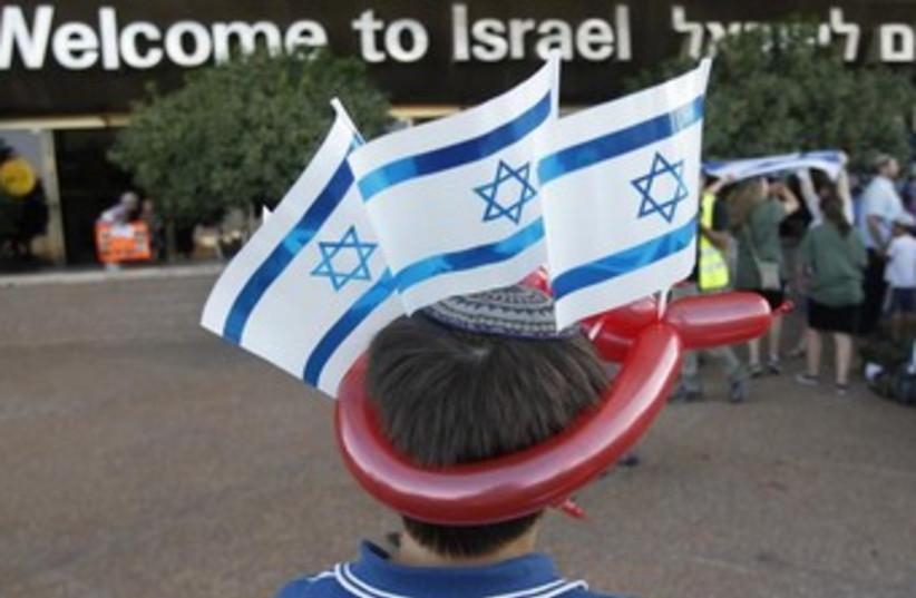 Boy wearing Israeli flags 370 (photo credit: REUTERS)