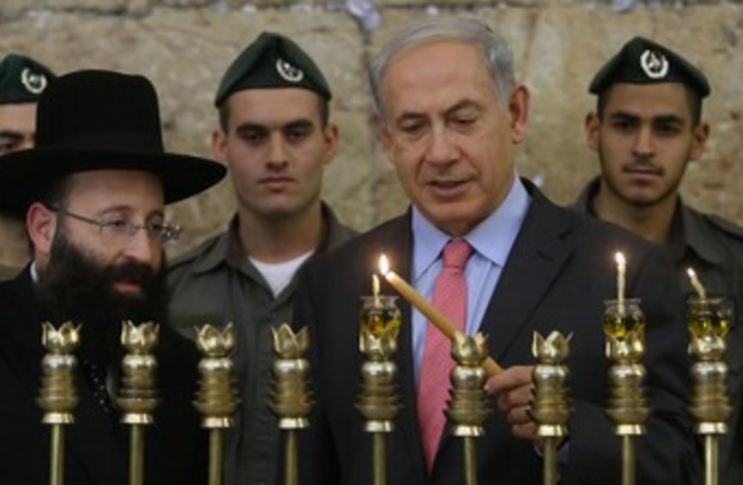 Netanyahu lighting Hanukka candles at Western Wall 370 (photo credit: Marc Israel Sellem/The Jerusalem Post)