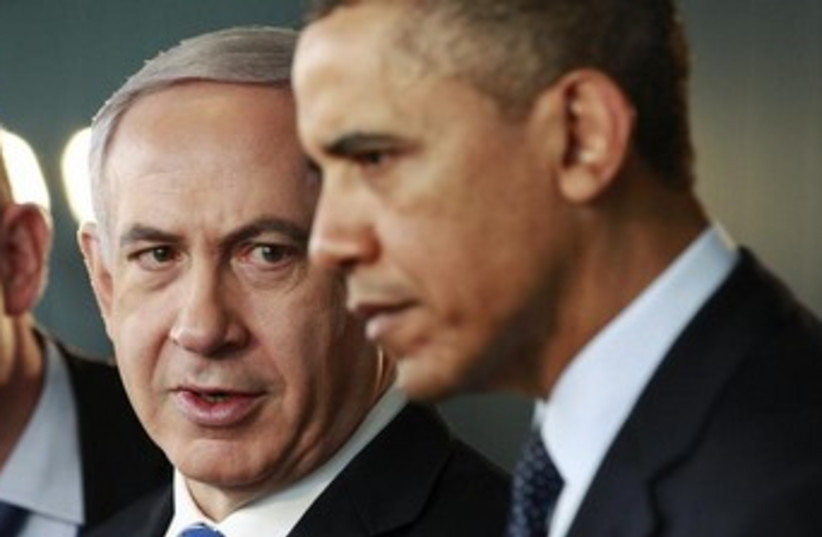 Netanyahu looks at Obama with serious expression 370 (photo credit: REUTERS/Jason Reed)