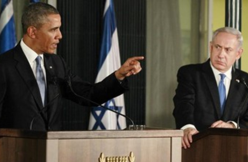 Netanyahu looks serious while Obama speaks 370 (photo credit: REUTERS/Jason Reed)