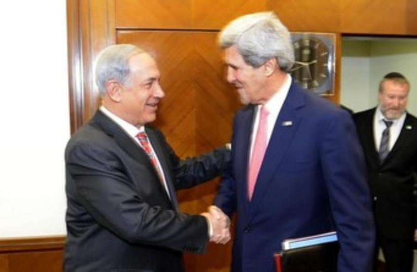 netanyahu and kerry shake hands 370 (photo credit: Matty Stern/U.S. Embassy Tel Aviv)