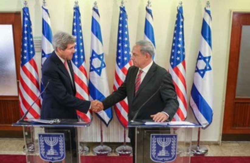 Kerry and Netanyahu shake hands at press conference 370 (photo credit: Noam Moskowitz/Pool)