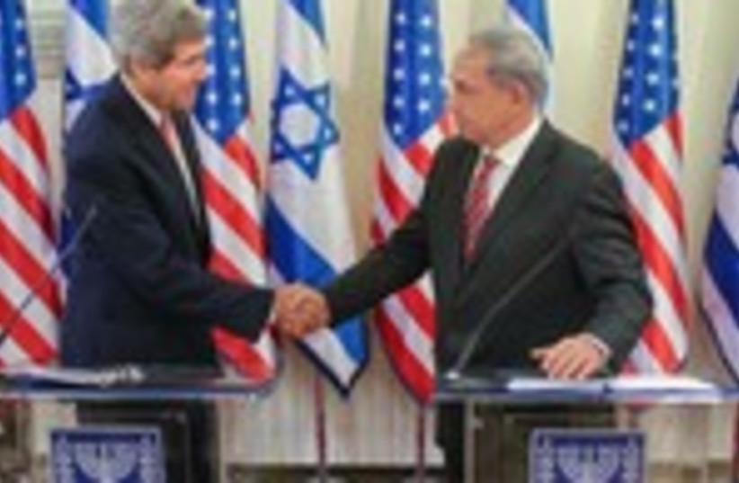 Kerry and Netanyahu shake hands at press conference 150 (photo credit: Noam Moskowitz/Pool)