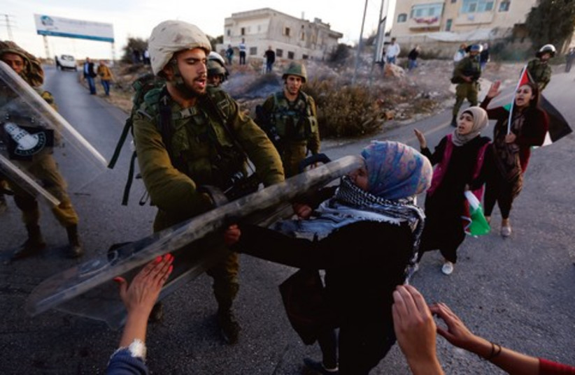 Beduin resettlemnt protest IDF 521 (photo credit: Reuters)